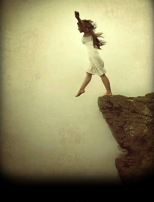 woman on cliff's edge