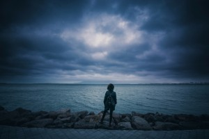 woman by cold dark water
