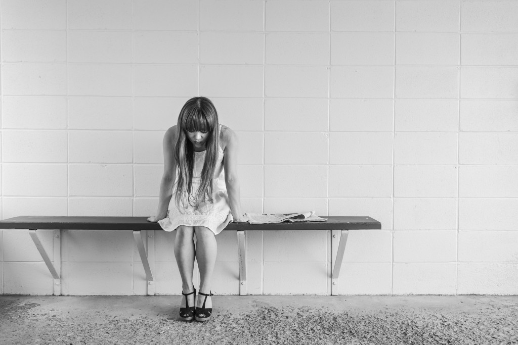 girl alone on bench