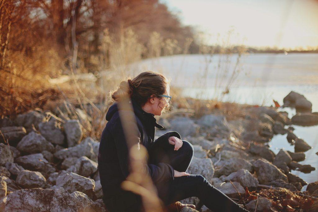 woman alone on rocks