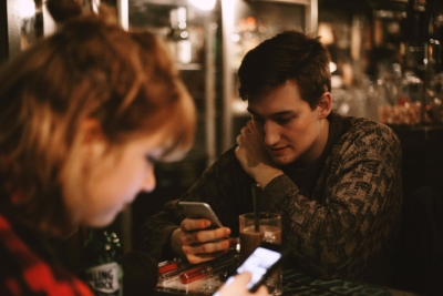 teens texting at table