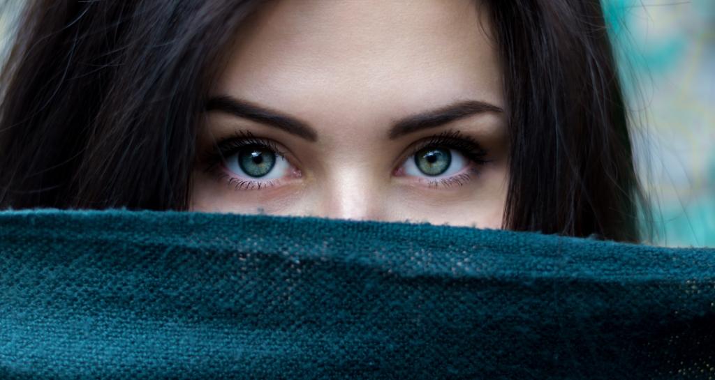 woman hiding behind fabric