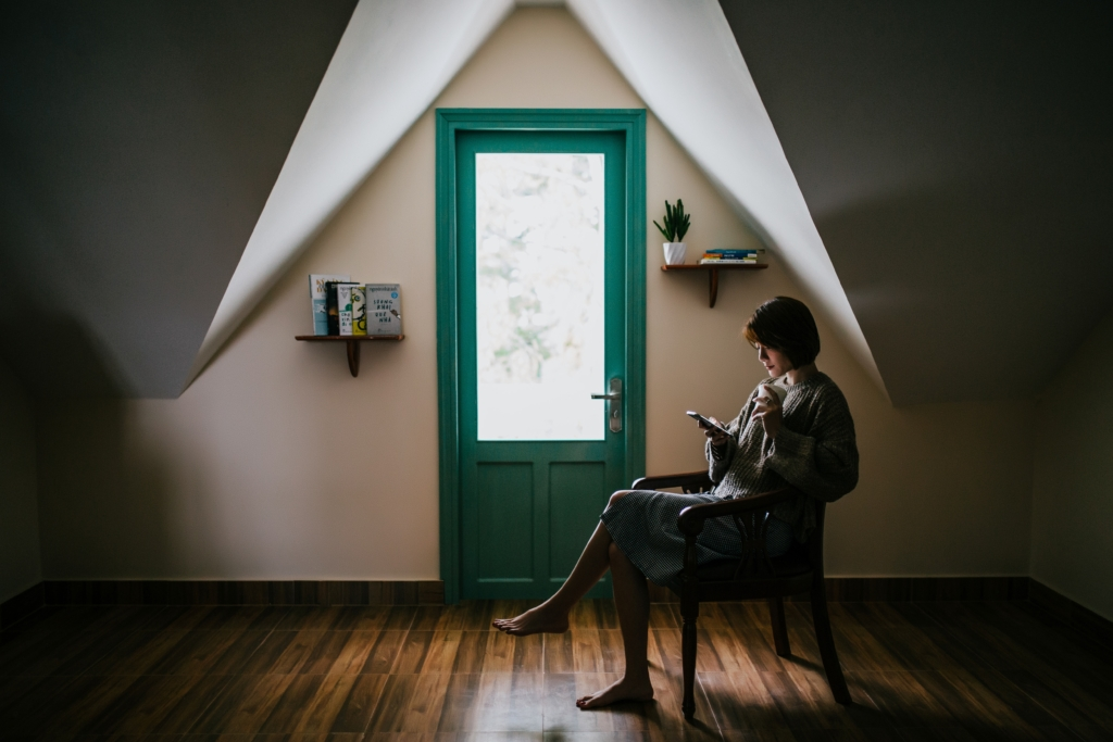 woman alone at home reading