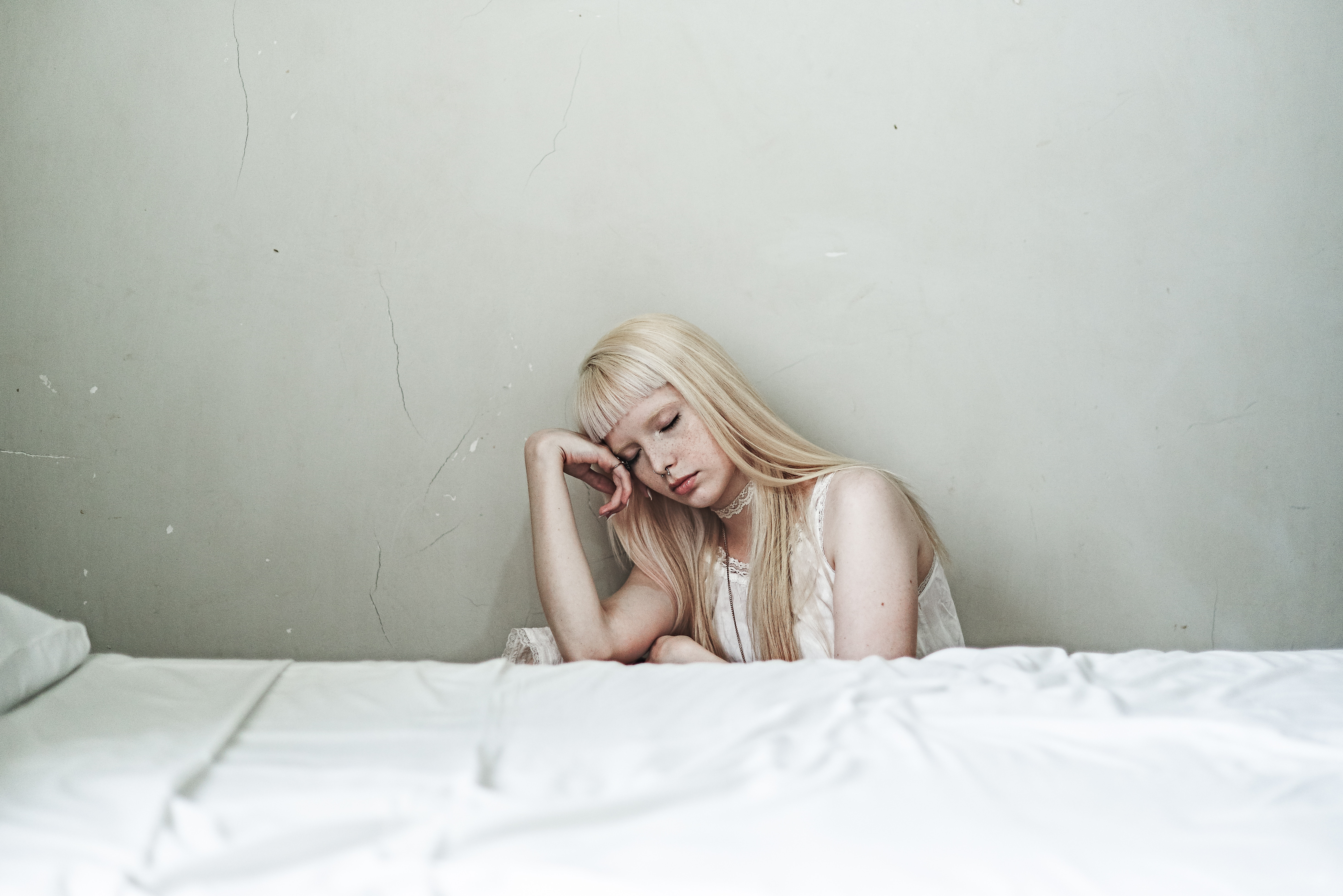 sad woman in white